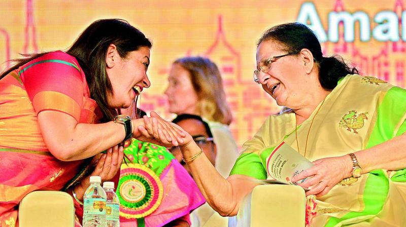 Lok Sabha Speaker Sumitra Mahajan (right) shares a lighter moment with Supreme  Court advocate Meenakshi Lekhi on the last day of National Women's Parliament in  Vijayawada on Sunday. (Photo: DC)