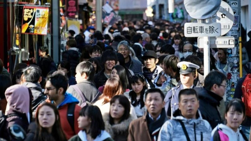 Many expect Tokyo and other large cities to empty as Japanese seize the rare opportunity for an overseas trip. (Photo: AFP)