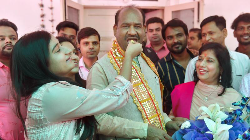Om Birla, NDA's nominee for Lok Sabha speaker's post, is offered sweets by family members at his residence, in New Delhi on Tuesday (Photo: AP)