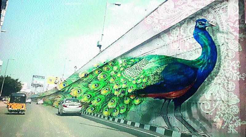 3D art coming up for the first time in India on flyovers. Theme is based on national bird peacock and Telangana state bird Palapitta. (Photo: DC)