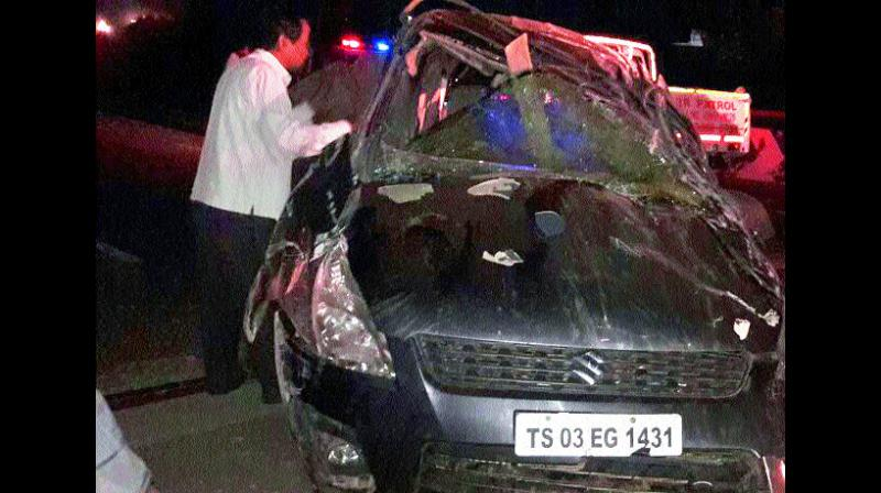 The mangled remains of the car that dashed into a divider at ORR.