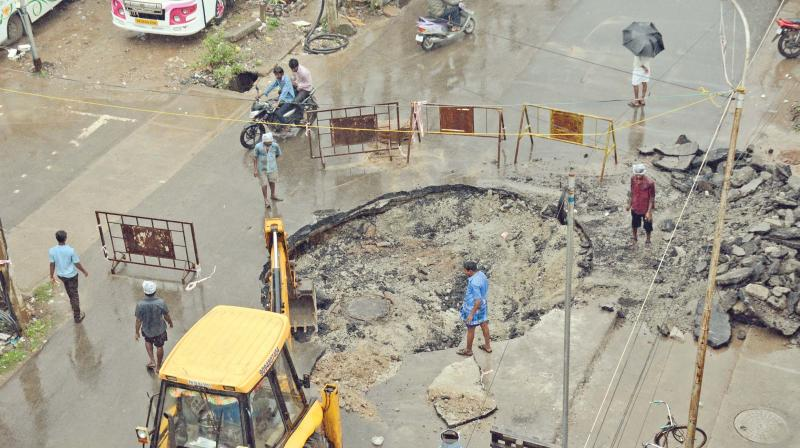 Chennai corporation workers relay damaged portion of a road in Padi on Friday. (Photo: DC)