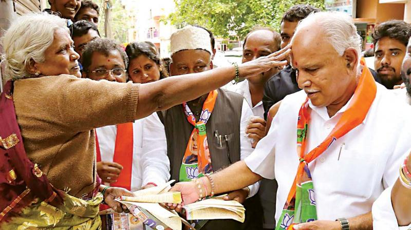 BJP state president and former CM B.S. Yeddyurappa during an awareness campaign launched by the party in Sampangiramnagar in Bengaluru on Tuesday.
