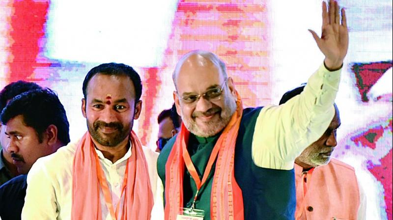 BJP president Amit Shah with MoS for home G. Kishan Reddy in Hyderabad on Saturday. Kickstarting the BJP's membership drive in the state, Shah urged partymen to work towards making Telangana state, Andhra Pradesh and Kerala the party's strongholds.