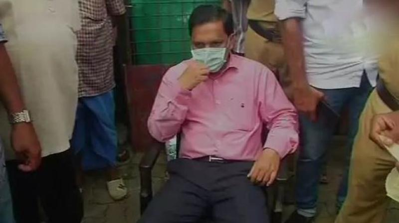 Kochi's sub-judge A M Basheer during the sit-in protest. (Photo: ANI | Twitter)