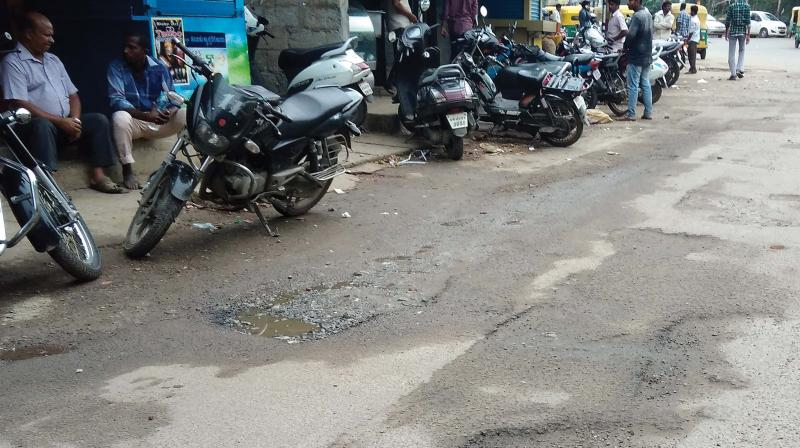 Despite numerous complaints, the roads in Ejipura continue to be full of potholes 	(Photo:DC)