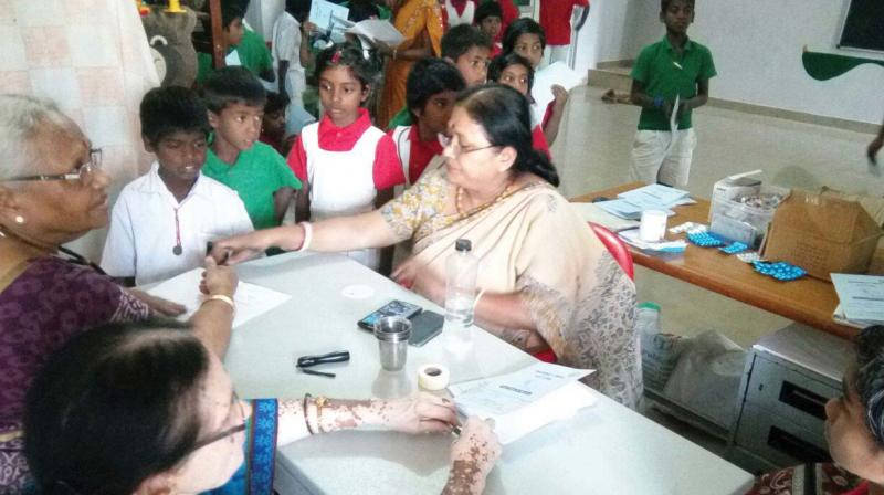 V. Annapoorna Ram and her team taking care of abandoned children.