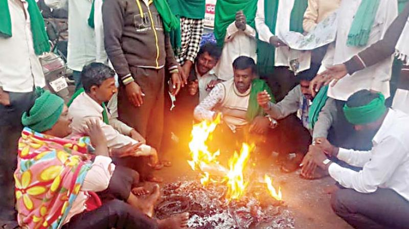Farmers stage a protest to press for their various demands on Tuesday in Belagavi where the winter  session of the state legislature is now being held