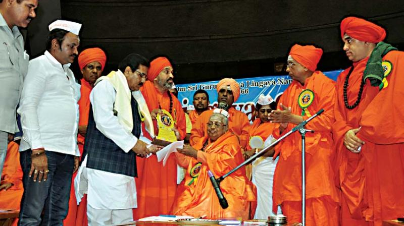 A view of the proceedings at the Lingayat conference held at Talkatora Stadium in New Delhi