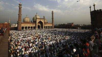Muslims hug and greet each other after the prayers in the premises of the Jama Masjid in Delhi. (Photo: AP/Manish Swarup)