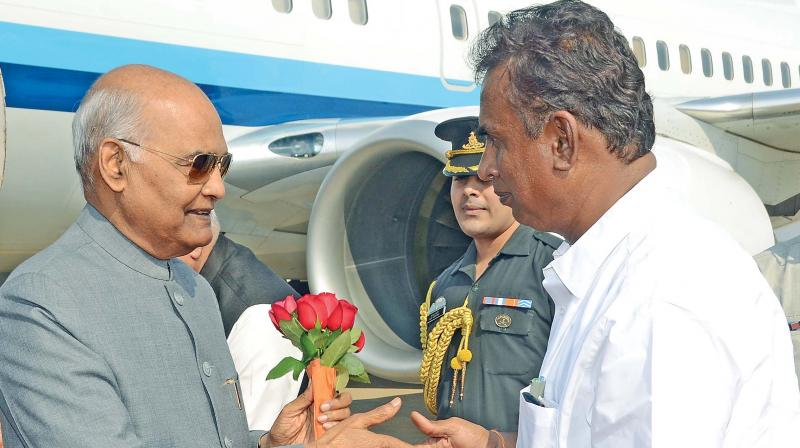 Minister for municipal administration and rural development S.P Velumani receives President Ram Nath Kovind by presenting a bouquet in Coimbatore on Sunday. (Photo: DC)