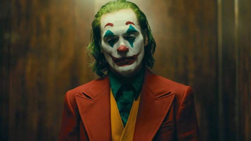 Joaquin Phoenix as Joker.