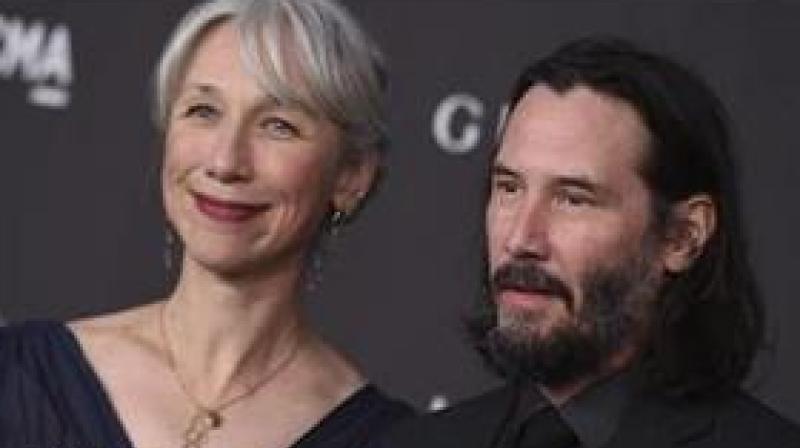 Helen Mirren with Keanu Reeves.