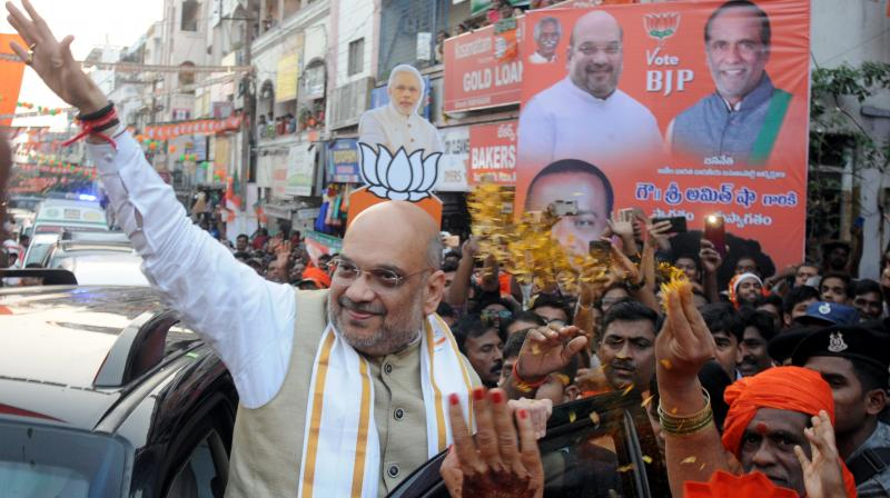 BJP president Amit Shah during a road show road show at Ramnagar on Wednesday.  (Deepak Deshpande)