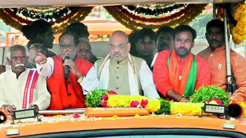 BJP national president Amit shah along with party's Telangana state president K. Laxman, leaders Bandaru Dattreya and Kishan Reddy participate in a the road show at Ramnagar on Wednesday.  (Deepak)