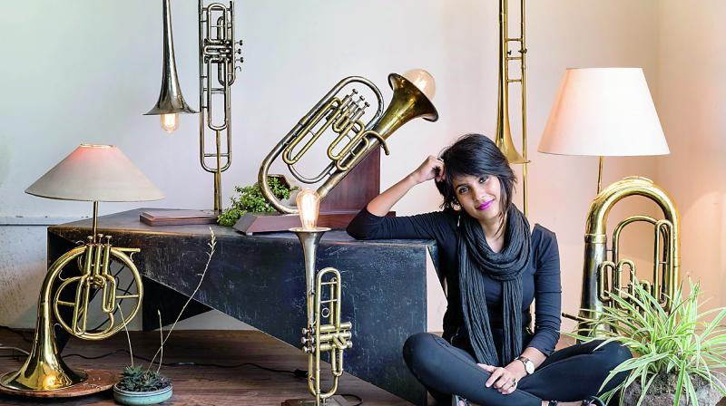 Advaeita Mathur poses with her Vintage Instrument Lamps Project collection.