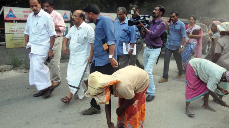 PWD minister G. Sudhakaran and P.T. Thomas MLA inspect the road repairing works at Civil Line Road in Kochi on Friday. —DC
