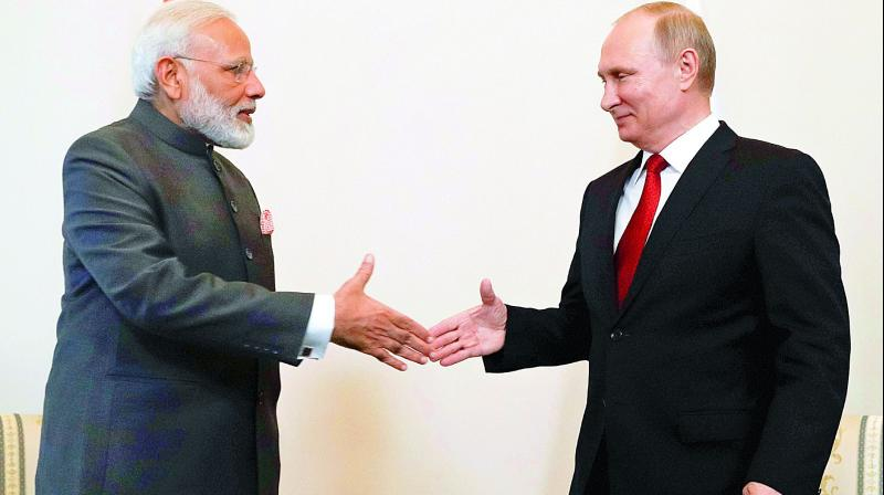Russian President Vladimir Putin shakes hands with Prime Minister Narendra Modi prior to their talks at the International Economic Forum in St. Petersburg, Russia, on Thursday. (Photo: PTI)