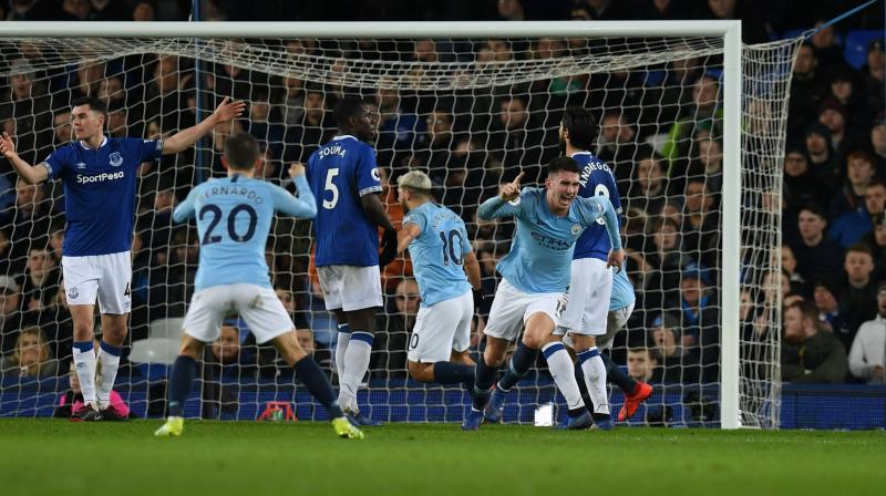 Pep Guardiola's side took the lead through Aymeric Laporte's header on the stroke of half-time at Goodison Park. (Photo: AFP)
