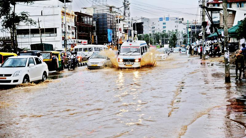 The rain struck during peak hours just when office-goers were returning home. Commuters were stuck in bumper-to-bumper traffic as roads were flooded and trees fell.