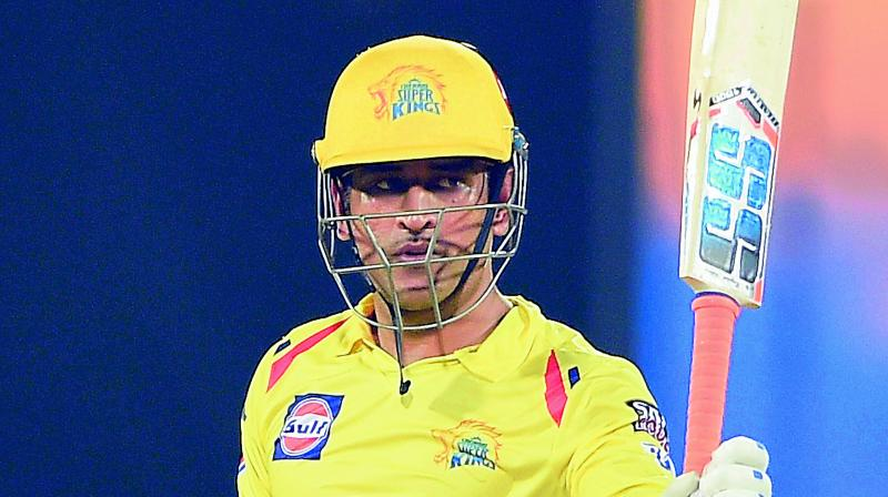 CSK skipper M. S. Dhoni celebrates his half century against Rajasthan Royals on Sunday.	 (PTI)