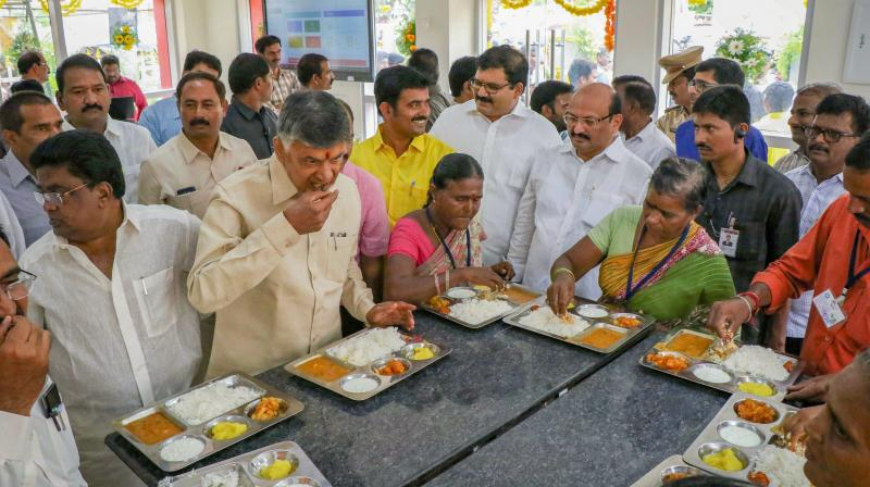 Andhra Pradesh Chief Minister N Chandrababu Naidu has lunch during the launch of Phase I of 'Anna Canteens' on Wednesday. (Photo: PTI)
