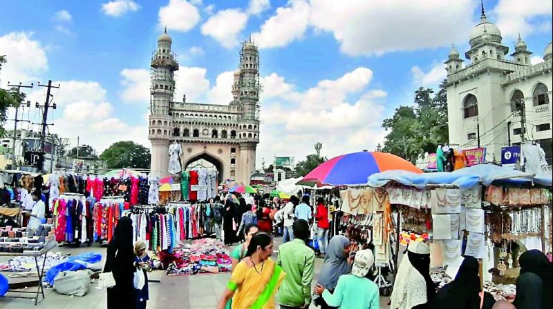 Hawkers have once again captured footpaths around the Charminar. (Photo: Deccan Chronicle)