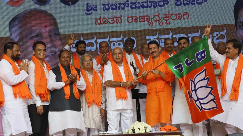 Nalin Kumar Kateel takes charge as BJP state president in the presence of CM B.S. Yediyurappa and state BJP Leaders during a programme at the BJP office in Bengaluru on Tuesday