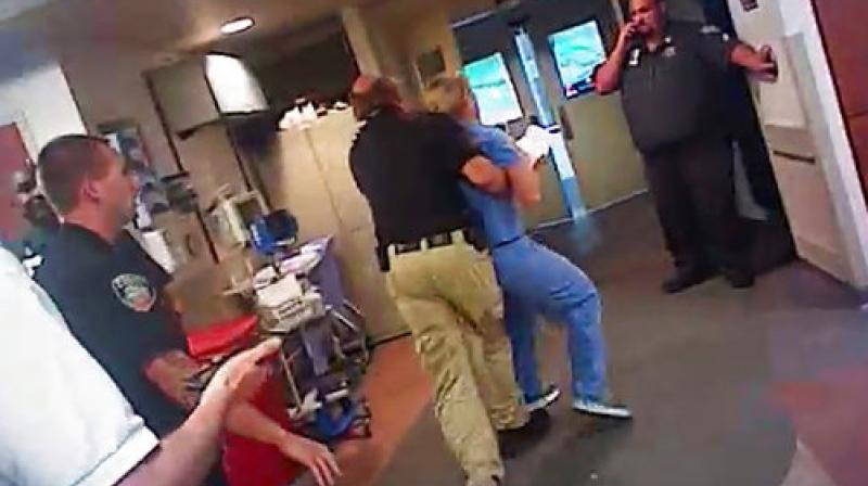 In this July 26, 2017, frame grab from video taken from a police body camera and provided by attorney Karra Porter, nurse Alex Wubbels is arrested by a Salt Lake City police officer at University Hospital in Salt Lake City. (Photo: AP)