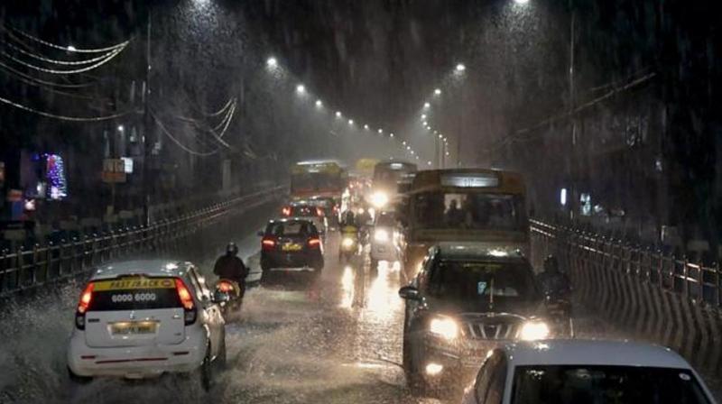 Vehicles move through a waterlogged road as heavy rains lash Chennai. (Photo: PTI)