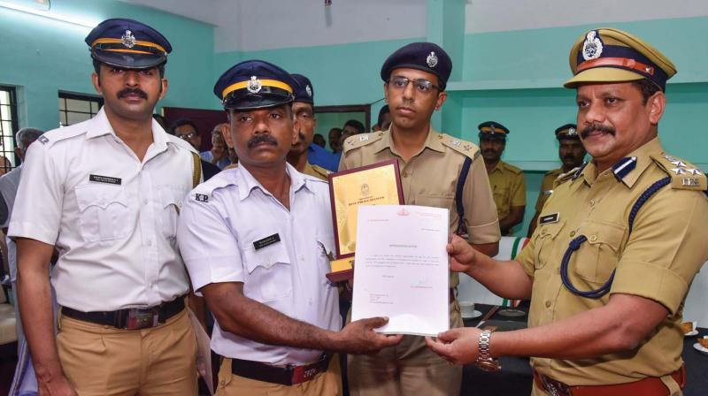 Bijukumar and Sharth Chandran of City traffic police station being given citation by the city police commissioner S Surendran on Saturday for catching a chain snatcher who snatched the gold chain of elderly women within two hours of the incident.