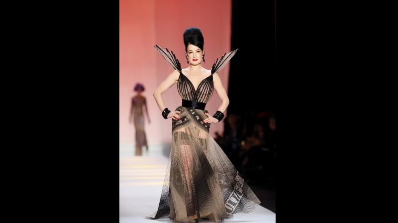 62d3e8d66ad ... Paris Fashion Week. The French couturier