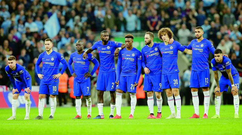 Chelsea players during the penalty shootout in their League Cup final against Manchester City at Wembley on Sunday. (Image: AP)