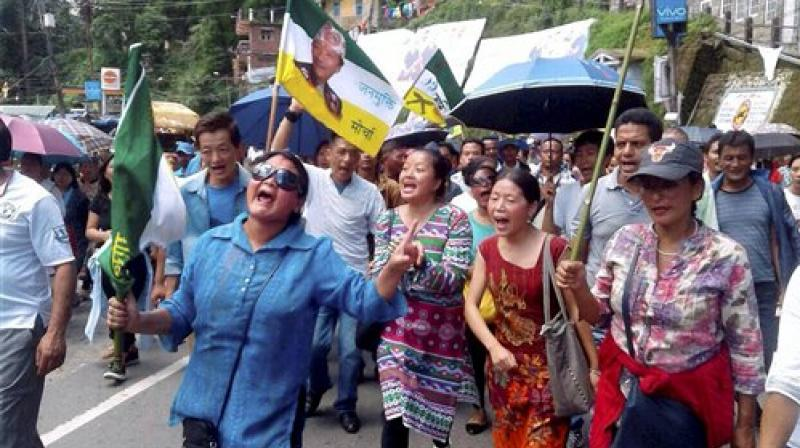 GJM supporters holding a rally for separate Gorkhaland in Darjeeling on Monday. (Photo: PTI)
