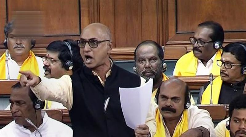 TDP MP Jayadev Galla speaks in the Lok Sabha on no-confidence motion during the Monsoon session of Parliament, in New Delhi. (LSTV GRAB via PTI)