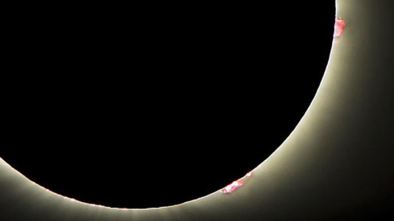 This photo shows solar flares as the sun emerges from a total eclipse by the moon, Monday, Aug. 21, 2017, in Dayton, Tenn. (Photo: AP)