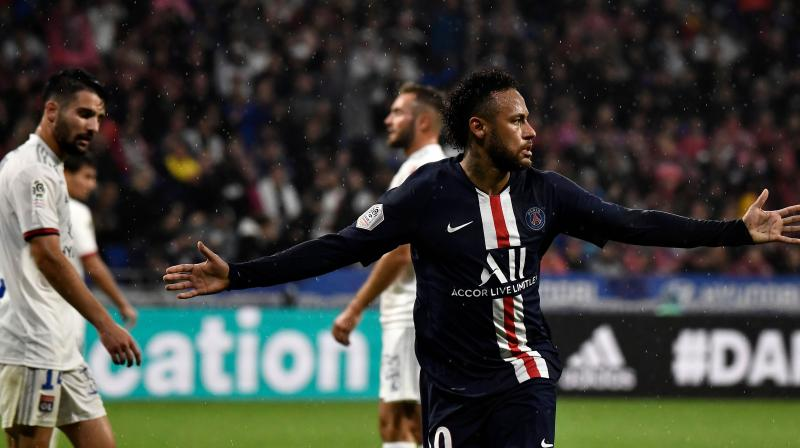 Neymar scored a fine late winner as Paris Saint-Germain beat Lyon 1-0 to move three points clear at the top of the Ligue 1 table. (Photo:AFP)