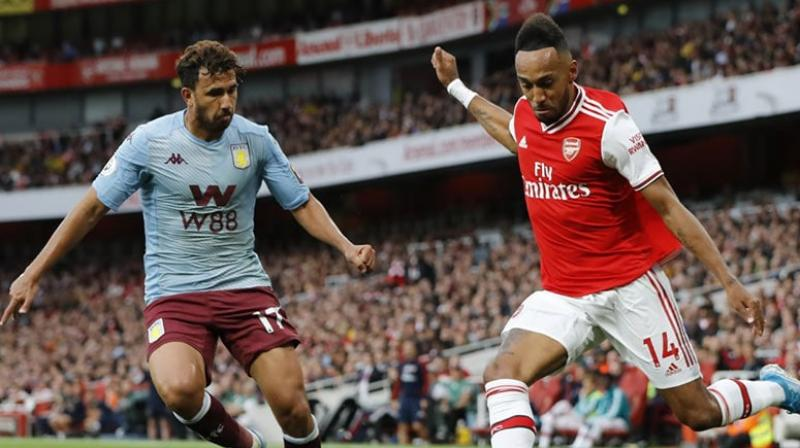 Ten-man Arsenal twice came from a goal down to claim a much-needed 3-2 win over Aston Villa in dramatic fashion thanks to Pierre-Emerick Aubameyang's free-kick six minutes from time at the Emirates on Sunday. (Photo:AFP)