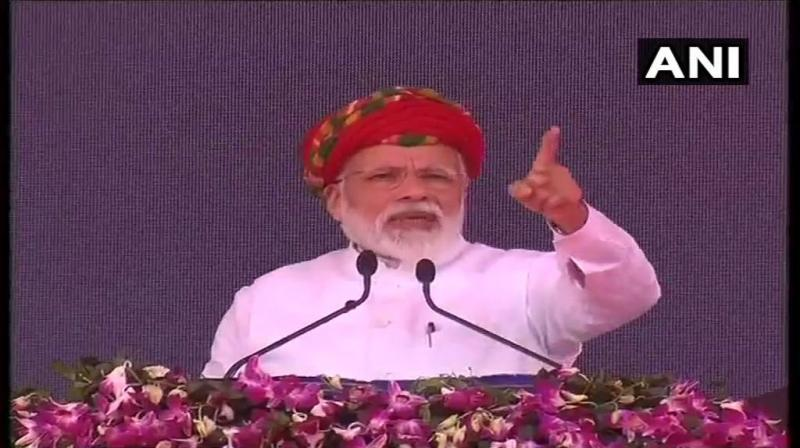 Prime Minister Narendra Modi on Monday addressed the public meeting in Jamnagar on a two-day visit to Gujarat. (Photo: ANI/ twitter)