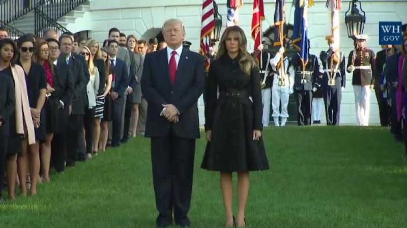 The president, and his wife, Melania, placed their hands on their hearts and bowed their heads as a bell tolled and a Marine played the mournful Taps on a trumpet. (Photo: Facebook)
