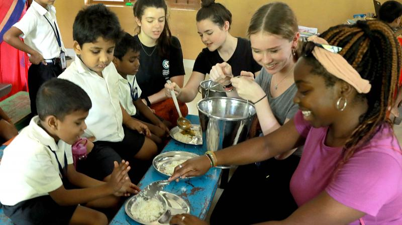 The visitors serve lunch to the students at Philomena's LP School, Koonammavu. (Photo: ARUN CHANDRA BOSE)