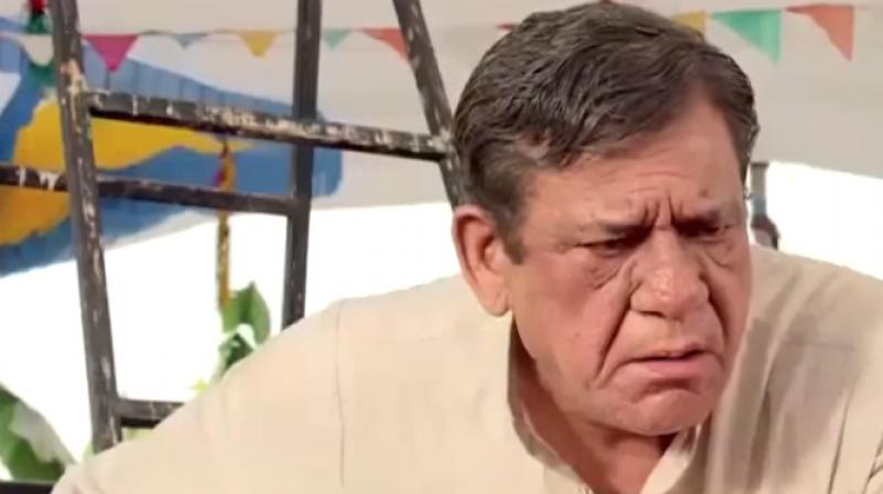 Om Puri in a still from the film.