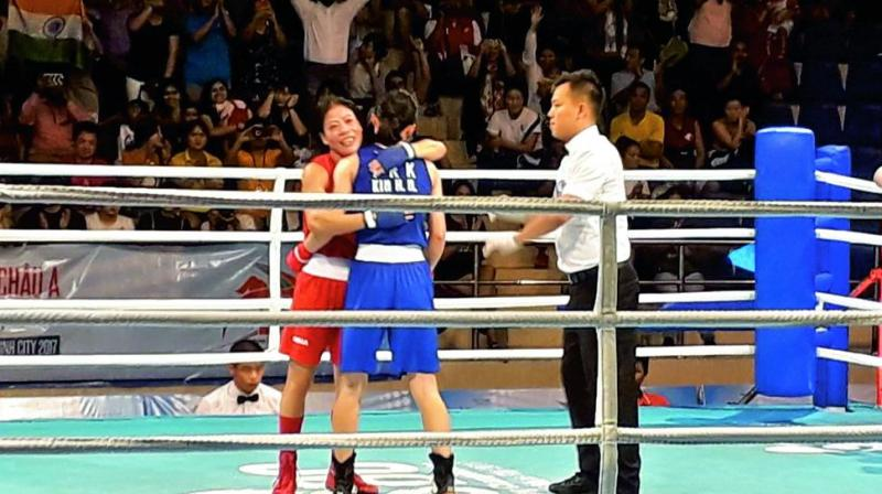 M.C. Mary Kom embraces North Korea's Kim Hyang Mi after the Asian Championships 48kg final in Ho Chi Minh City on Wednesday. Mary won by a 5-0 verdict.