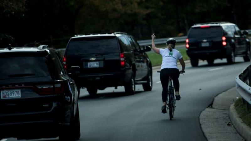 Juli Briskman, whose one-handed salute was captured in an AFP photograph that went viral, beat the Republican incumbent to a seat on the Loudoun County Board of Supervisors in state elections that saw Trump's Republican party suffer a series of stinging defeats. (Photo: AFP)