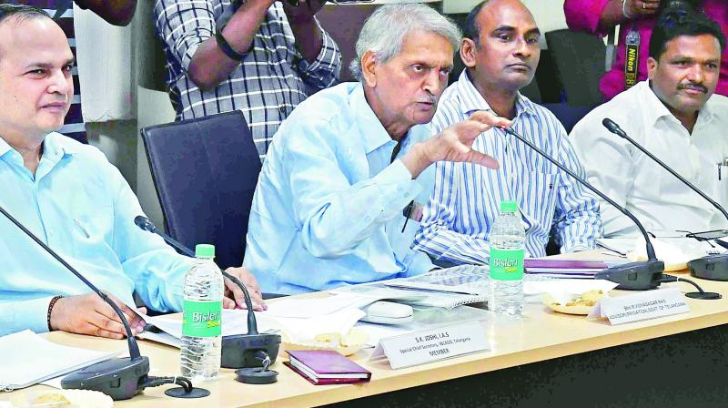 Adviser to the TS government R. Vidyasagar Rao and special chief secretary S.K. Joshi make a point during their meeting with the experts panel in Hyderabad.