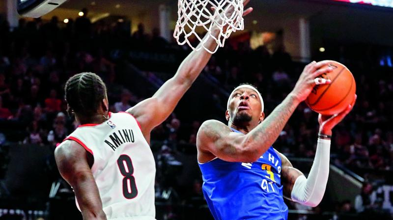 Portland Trail Blazers forward Al-Farouq Aminu (left) defends against Torrey Craig of Denver Nuggets during the first half of Game 6 of an NBA basketball second-round playoff series in Portland on Friday. (Photo: AP)