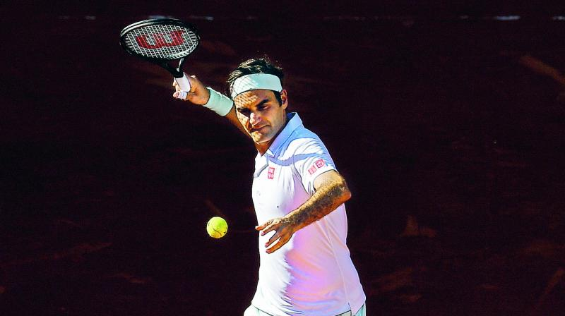 Roger Federer saved two match points to defeat Gael Monfils and reach the Madrid Open quarter-finals on Friday