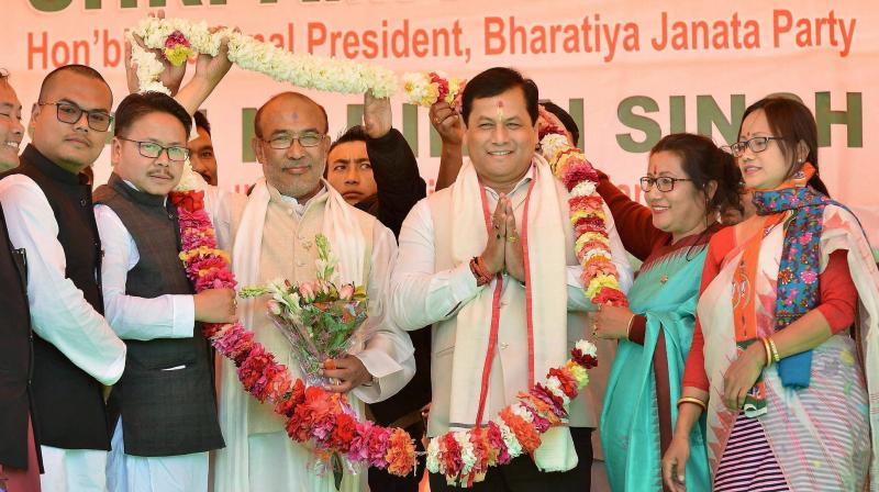 New Chief Minister of Manipur N Biren Singh with Assam Chief Minister Sarbananda Sonowal during the former's swearing-in ceremony in Imphal. (Photo: PTI)