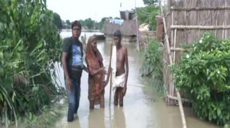 As many as 33 people have lost their lives due to the deluge, while approximately 26 lakh people in over 12 districts have been adversely affected by the calamity. (Photo: ANI)