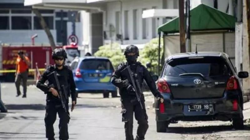 Police patrol outside Surabaya police headquarters following a suicide attack in Surabaya. (Photo: AFP)